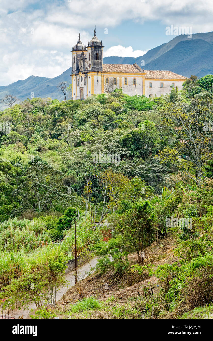 View of the Church of St. Francis of Paula in Ouro Preto in the mountains - Stock Image