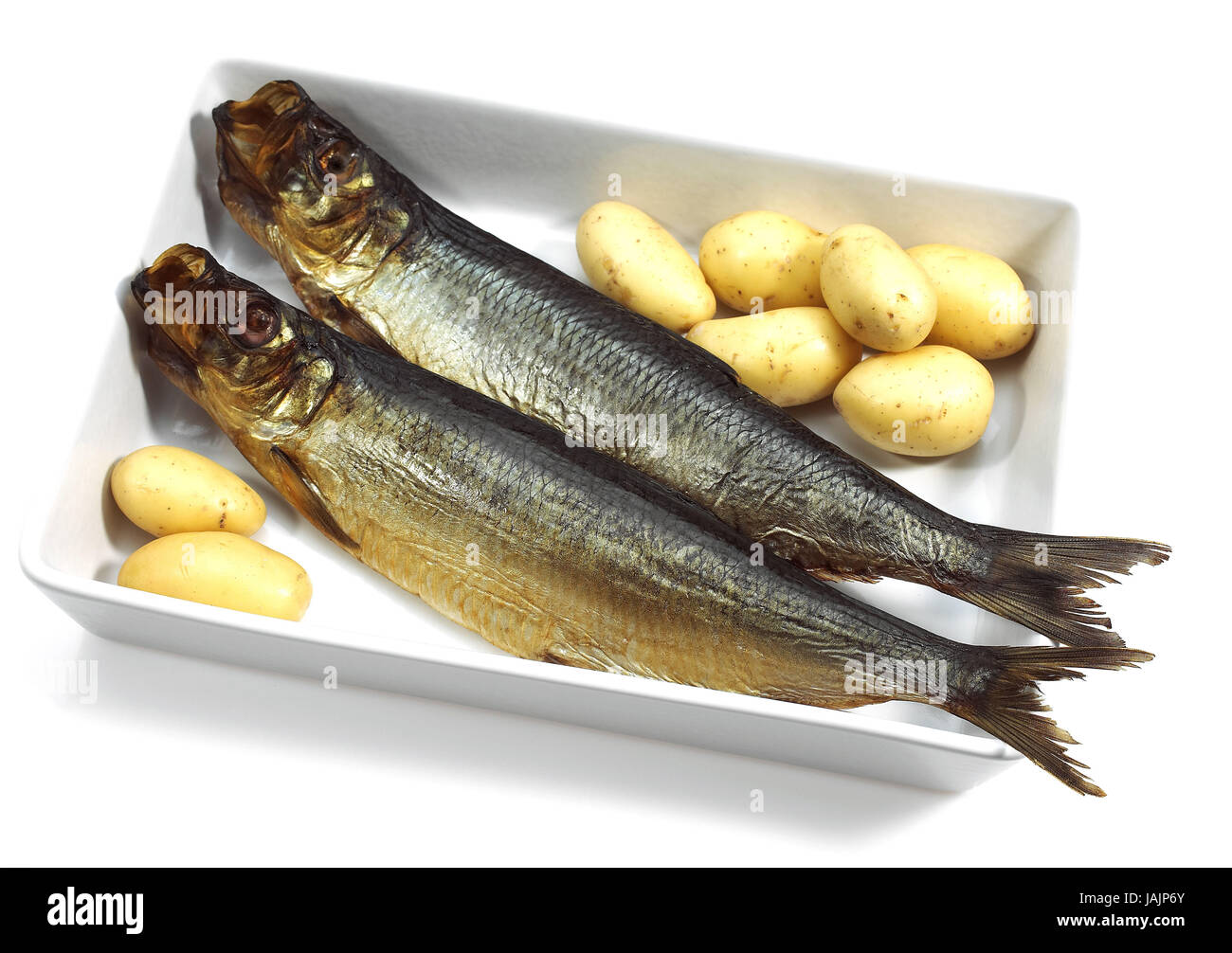Kipper or bloater,Clupea harengus,potatoes, - Stock Image