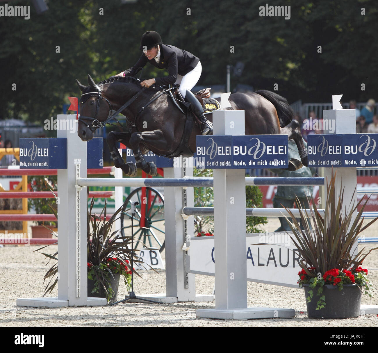 Horse-racing,German championships jumping and training in 2010 in Münster,Springreiterinnen,Eve Bitter on Satisfaction - Stock Image