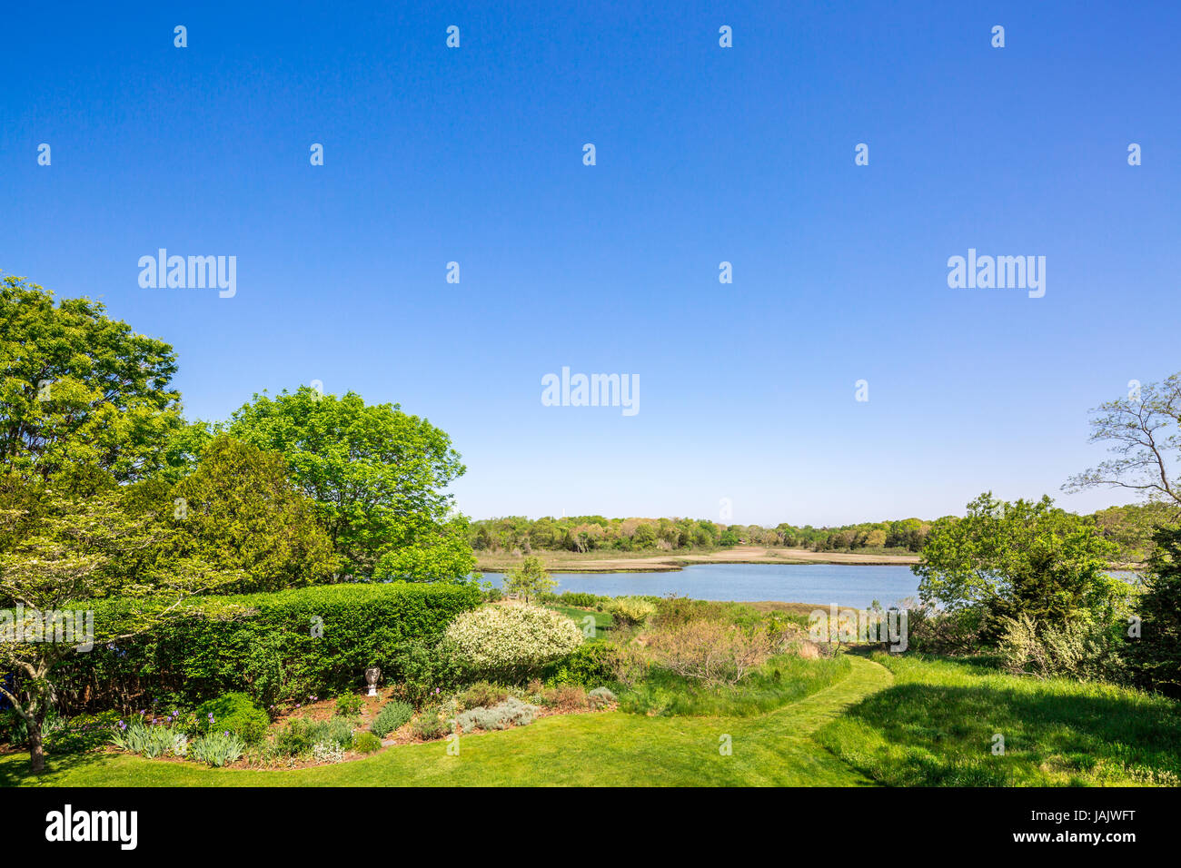 view of a quiet body of water connecting to long island sound - Stock Image