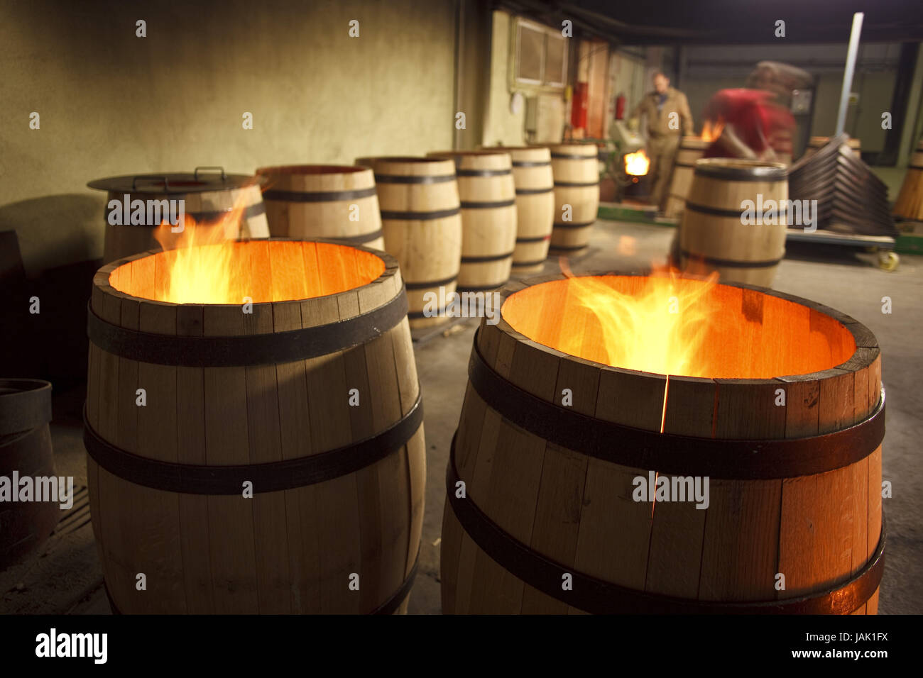 Spain,Navarre,Monteagudo,cooperage,wine,men,barrels,produce,fire