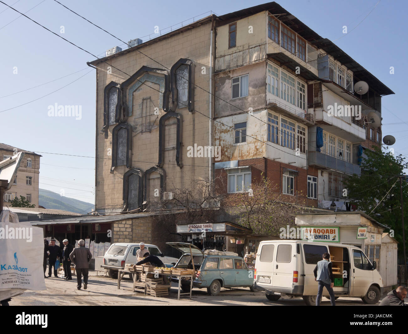 Building with old wall decorations at the  daily outdoors market in Şəki (transcribed Shaki or Sheki) in northern - Stock Image