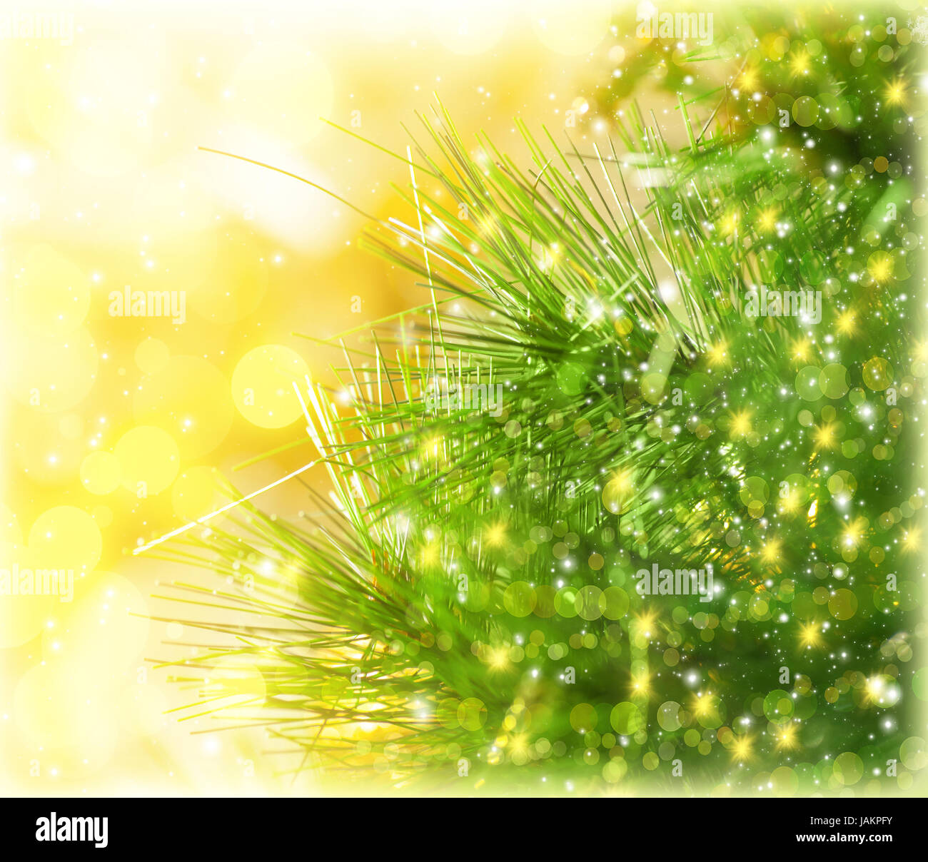 border green fir branch isolated on yellow blurred background christmastime decorations fresh pine tree twig decorated with golden glitters new year