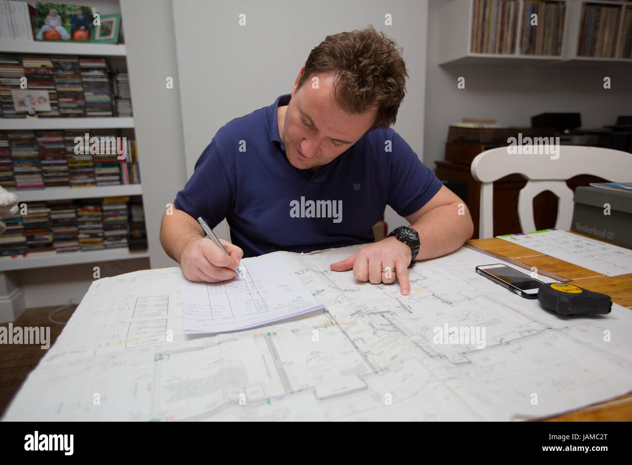 Quantity Surveyor working from home - Stock Image