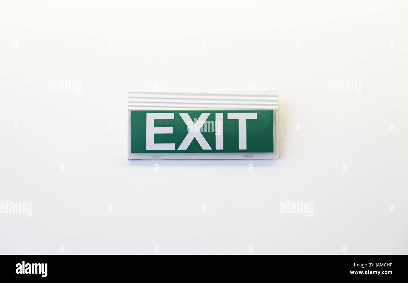 Exit Sign On White Wall Building And Construction Symbol Stock Photo