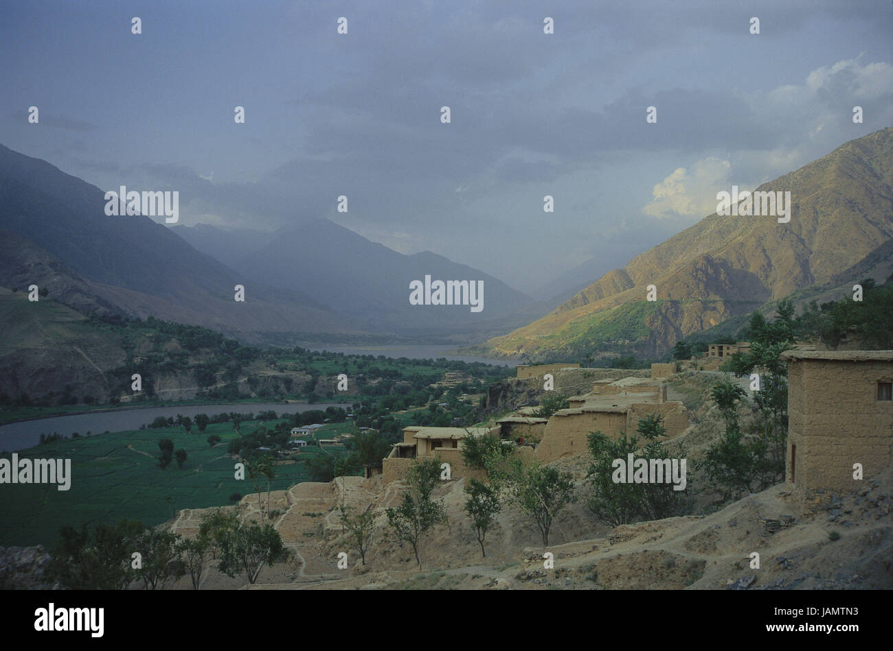 Pakistan,Chitral,scenery,river,place,Asia,mountains,mountains,view,nature,travel,mountain landscape,valley,houses,vegetation,sky,cloudies, - Stock Image