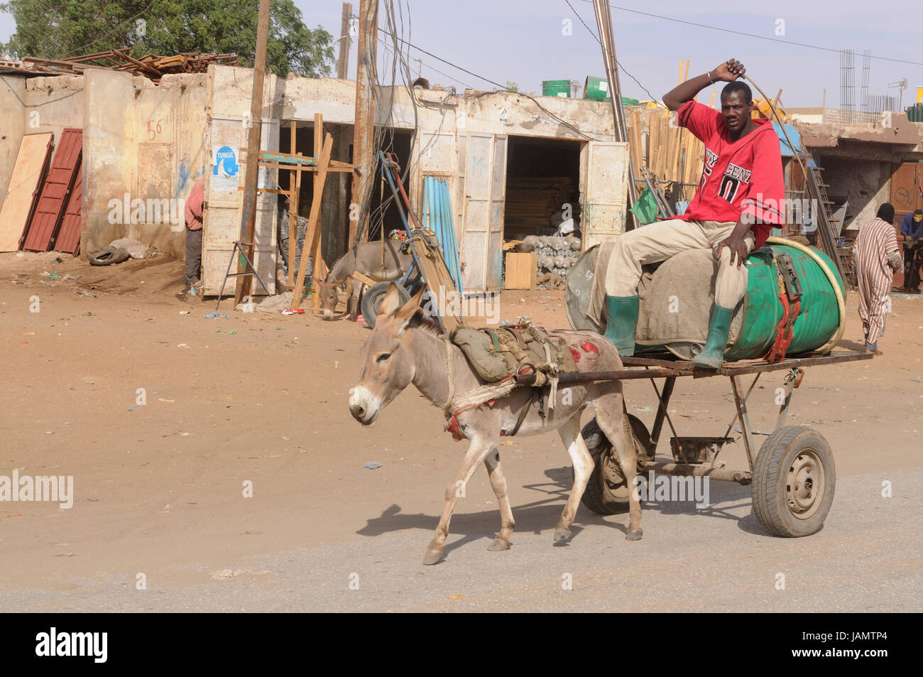 Mauritania,Nouakchott,man,donkey carts,costs transport,water barrel,no model release,Africa,West Africa,town,capital,economy,building,houses,architecture,person,locals,water Stock Photo