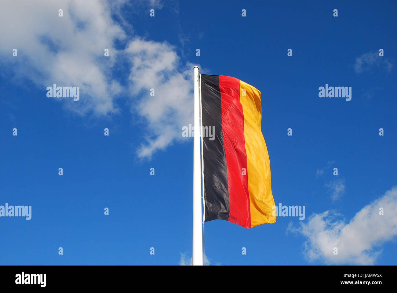 Flagpole,Germany flag,sky,mast,flag,flag,national flag,national colours,colours,black,red,gold,the FRG,in German,Germany,Germany - Stock Image