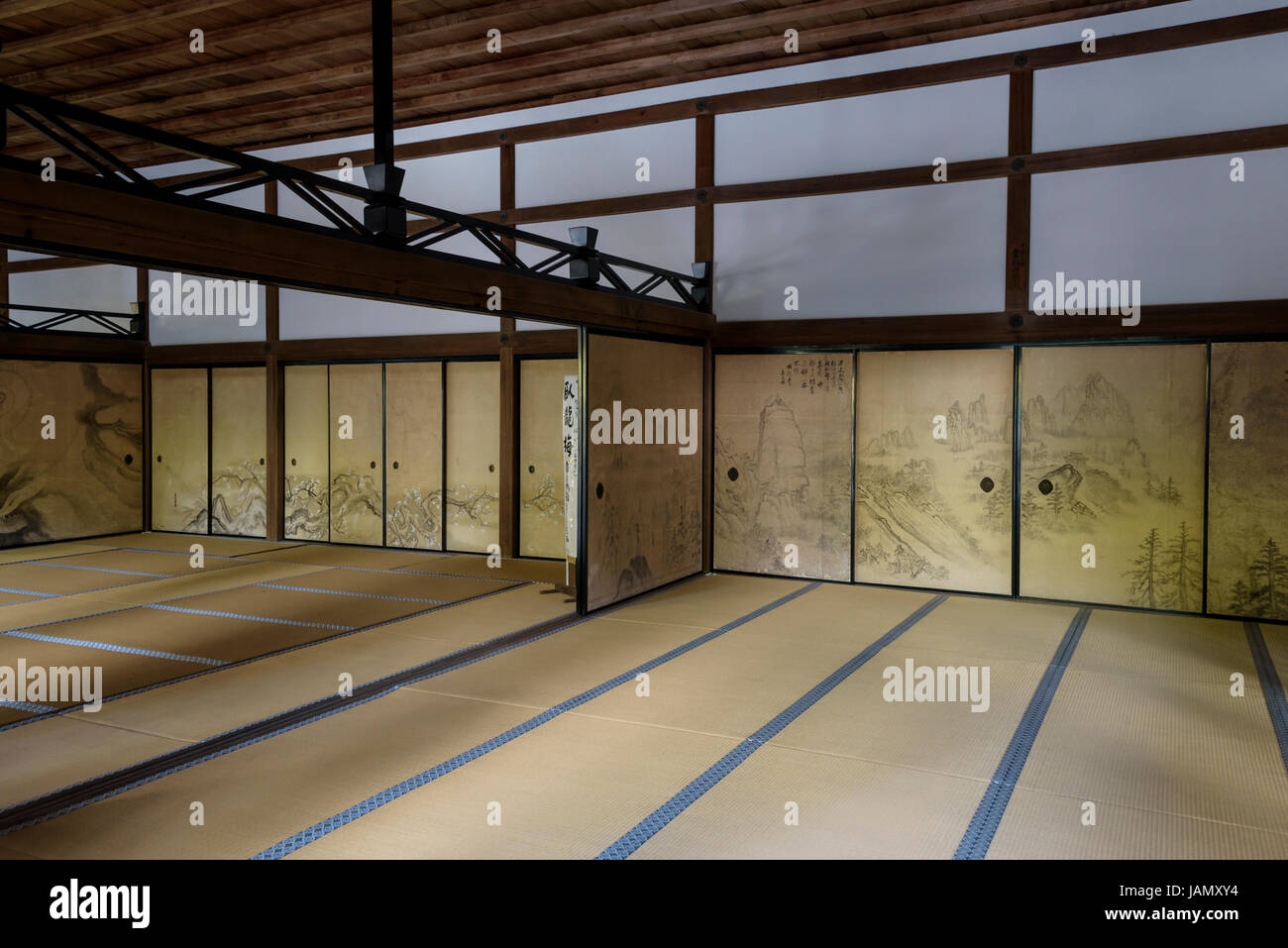 Interior of Kuri building at Ryoanji temple, with tatami mats and painted screens - Stock Image