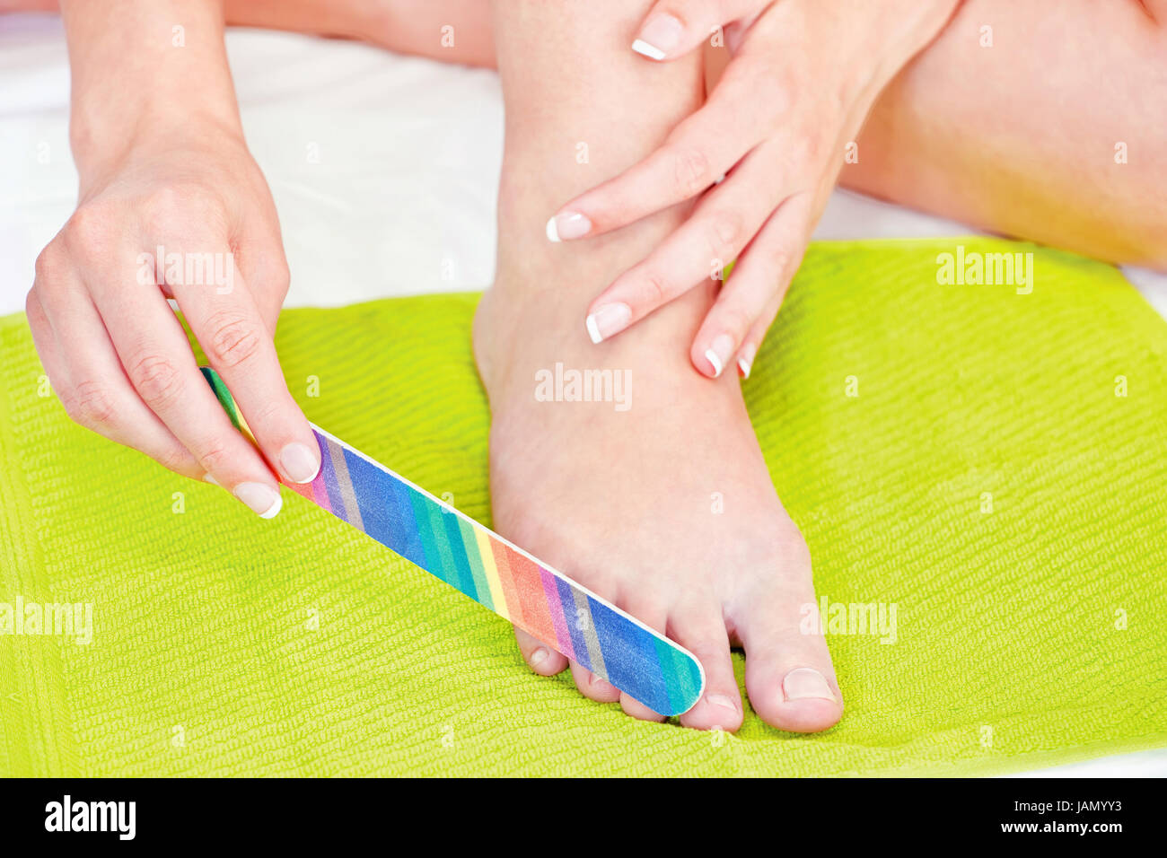 feet beauty treatment with nail file Stock Photo: 144290471 - Alamy