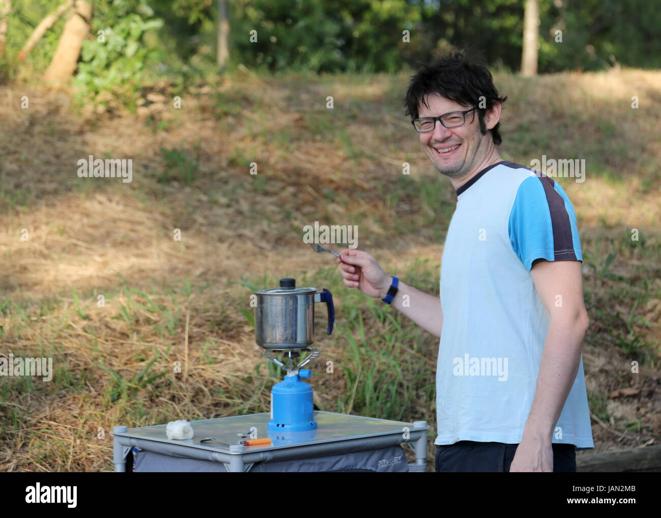 camper prepares dinner in the campsite of the resort Stock Photo