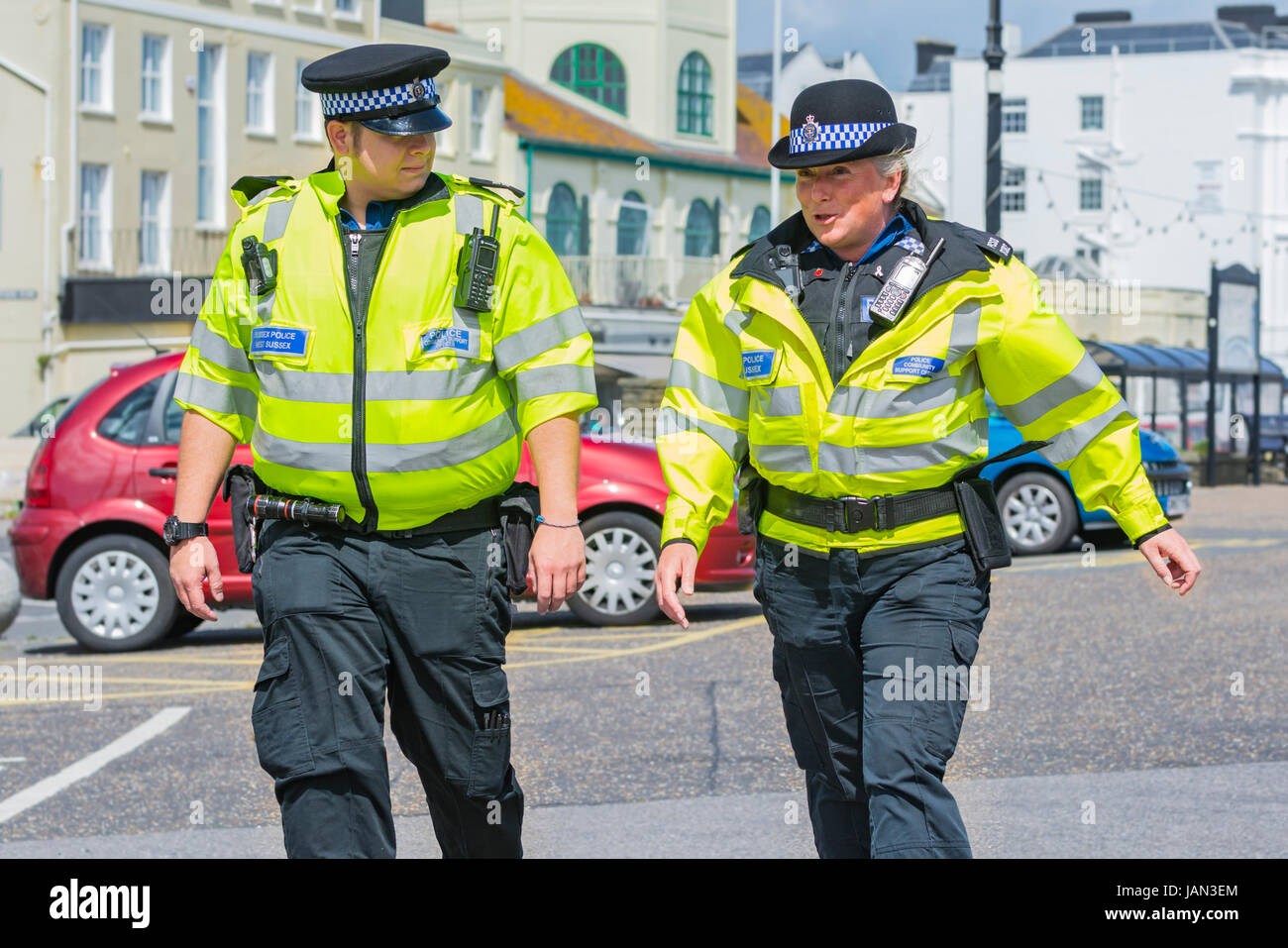 PCSO. Police Community Support Officers patrolling along the seafront promenade in West Sussex, UK. - Stock Image