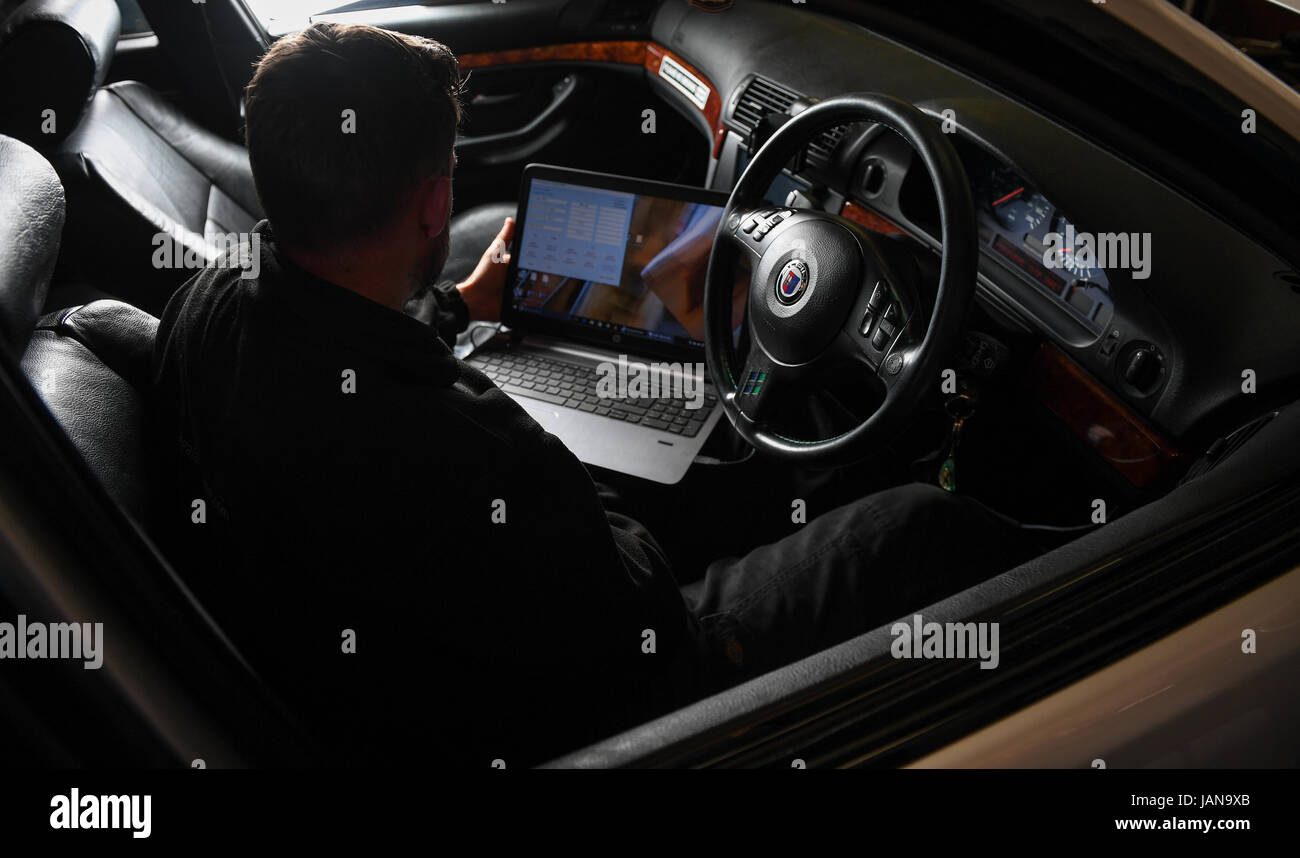 Car diagnostics testing on a BMW alpina - Stock Image