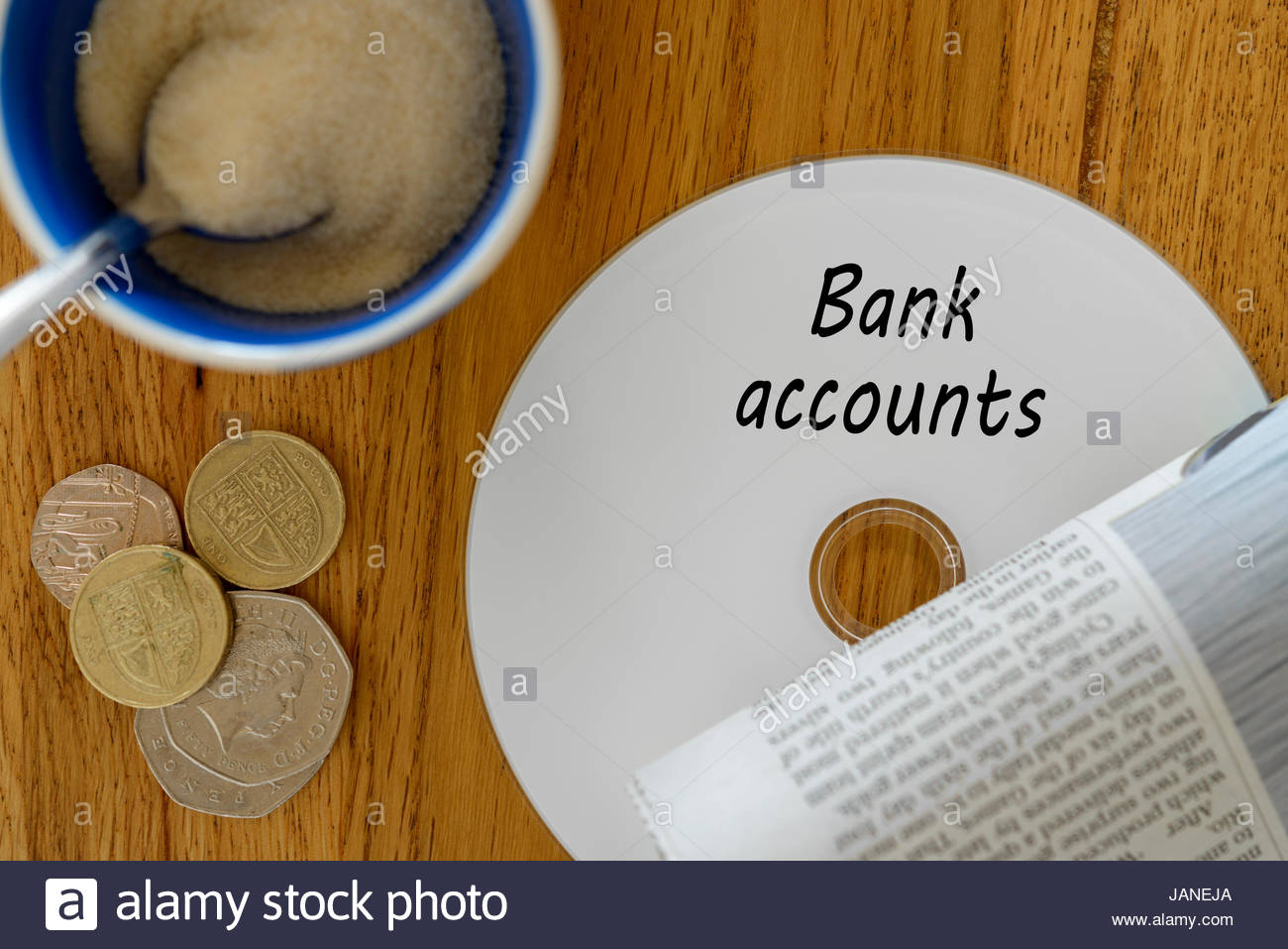 Bank accounts, data disc left on cafe table, Dorset, England. - Stock Image