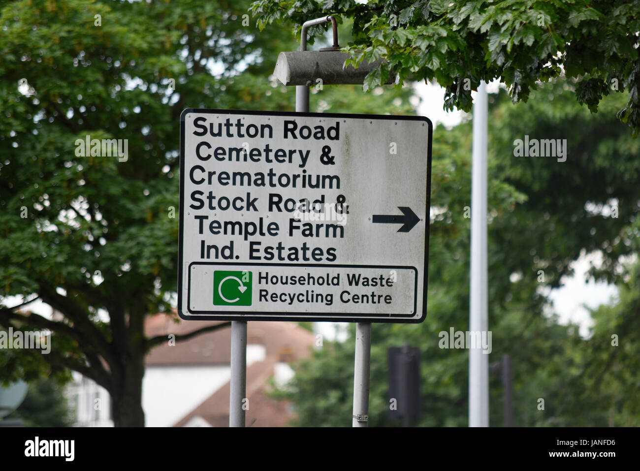 Road sign for Sutton Road, cemetery, crematorium, Stock Road, Temple Farm Industrial Estate, Household waste recycling - Stock Image