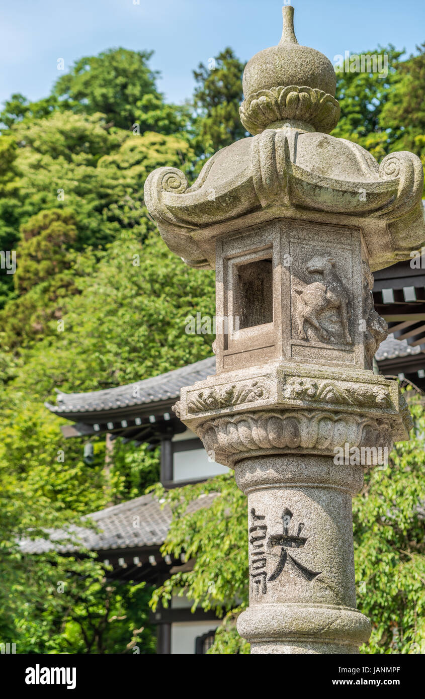 Stone lantern in the garden of the Hase-dera temple, commonly called the Hase-kannon, one of the Buddhist temples - Stock Image