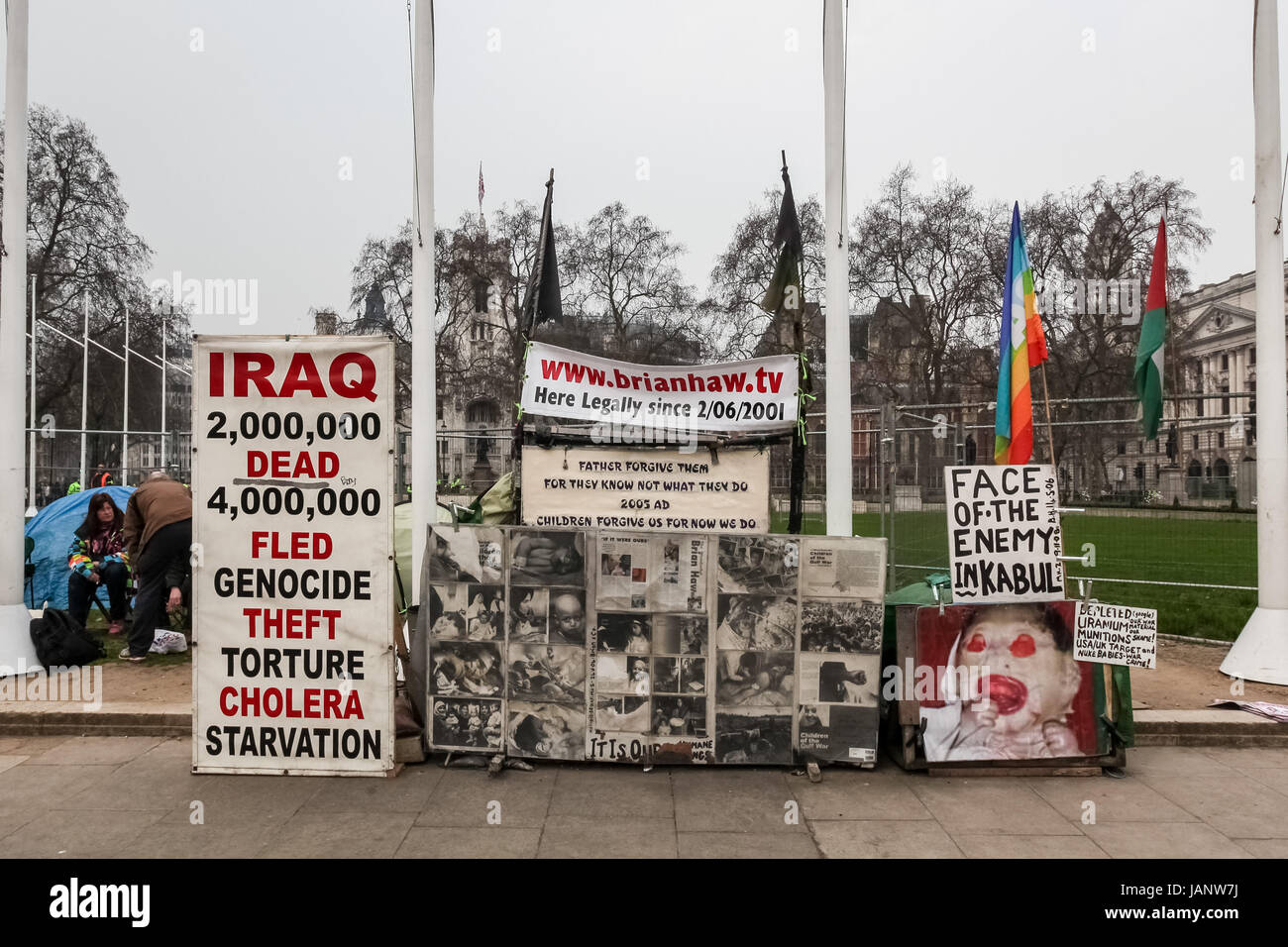 Placards at the peace camp of Brian Haw the long-term anti-war protester in Parliament Square, London, UK. - Stock Image