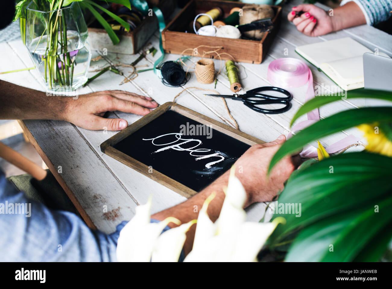 Handicraft flower shop open for service - Stock Image