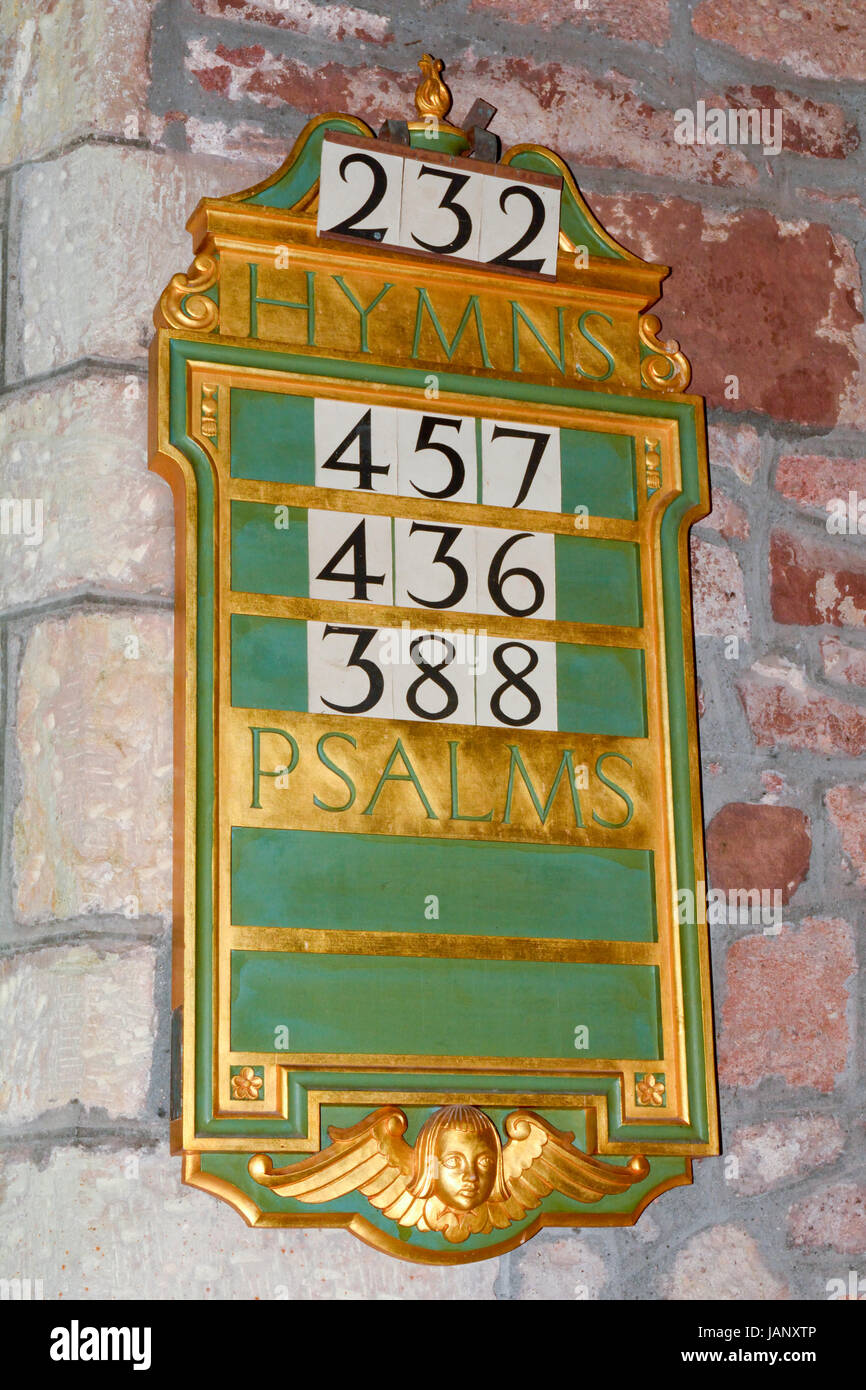 Hymns and Psalms board inside church to inform congregation of the hymns and psalms that will be part of the days Stock Photo