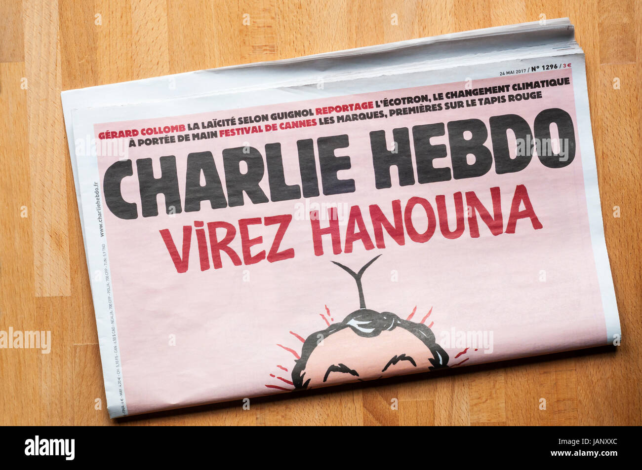 A copy of Charlie Hebdo, the French satirical newspaper. - Stock Image