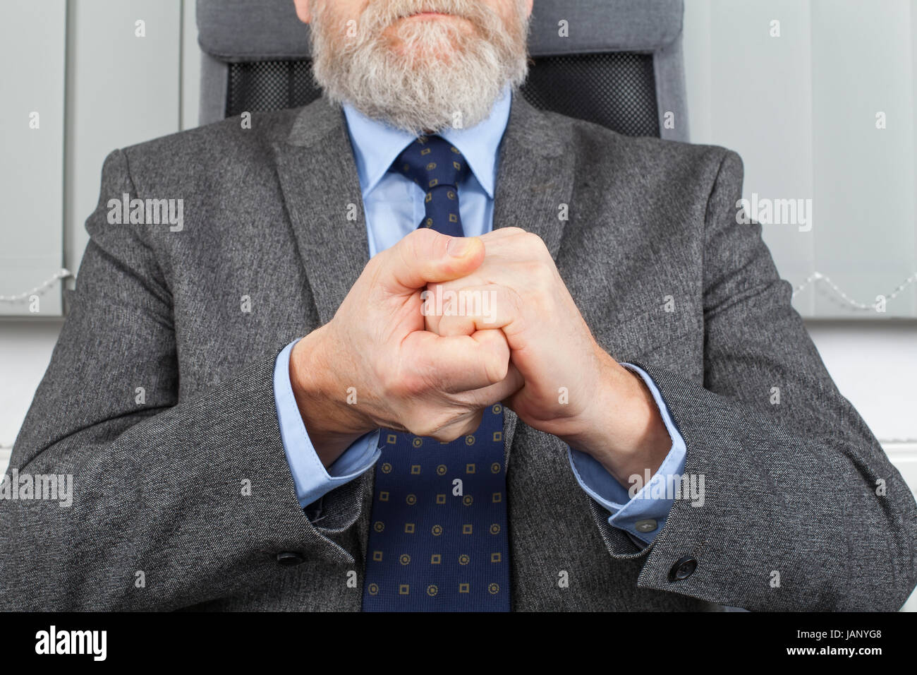 Close up picture of an elderly businessman's hands - Stock Image