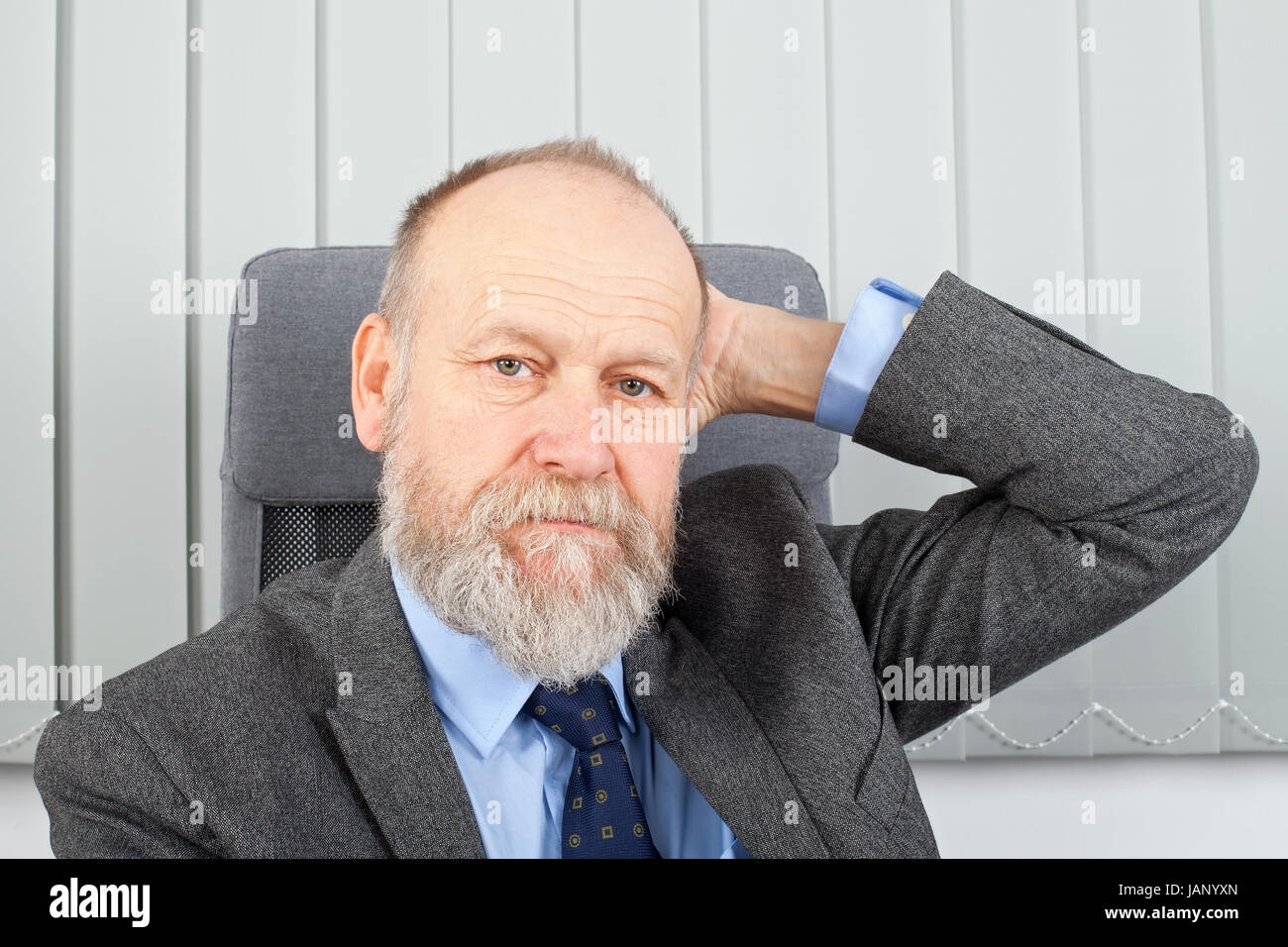 Picture of a thoughtful businessman at the office - Stock Image
