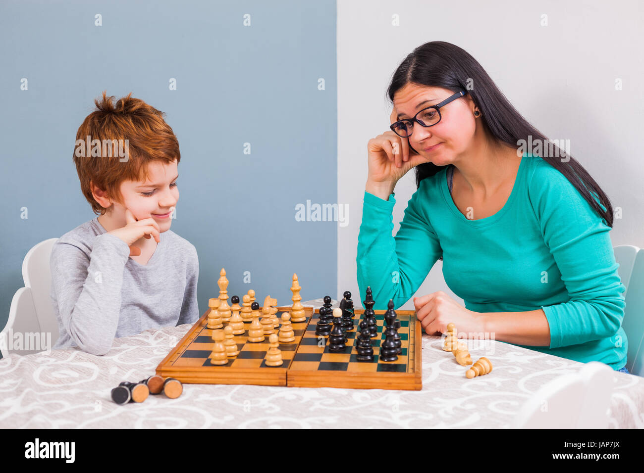 mother and her son are playing chess at home stock photo 144318466 rh alamy com chest at home workout chase at home employee login