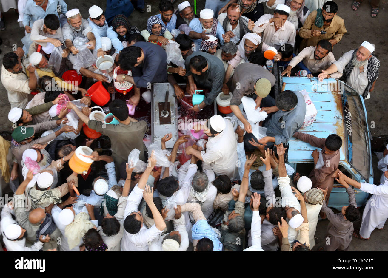 Watermelon juice is being distributing among Muslims as almsgiving by philanthropist during Holy Month of Ramzan Stock Photo
