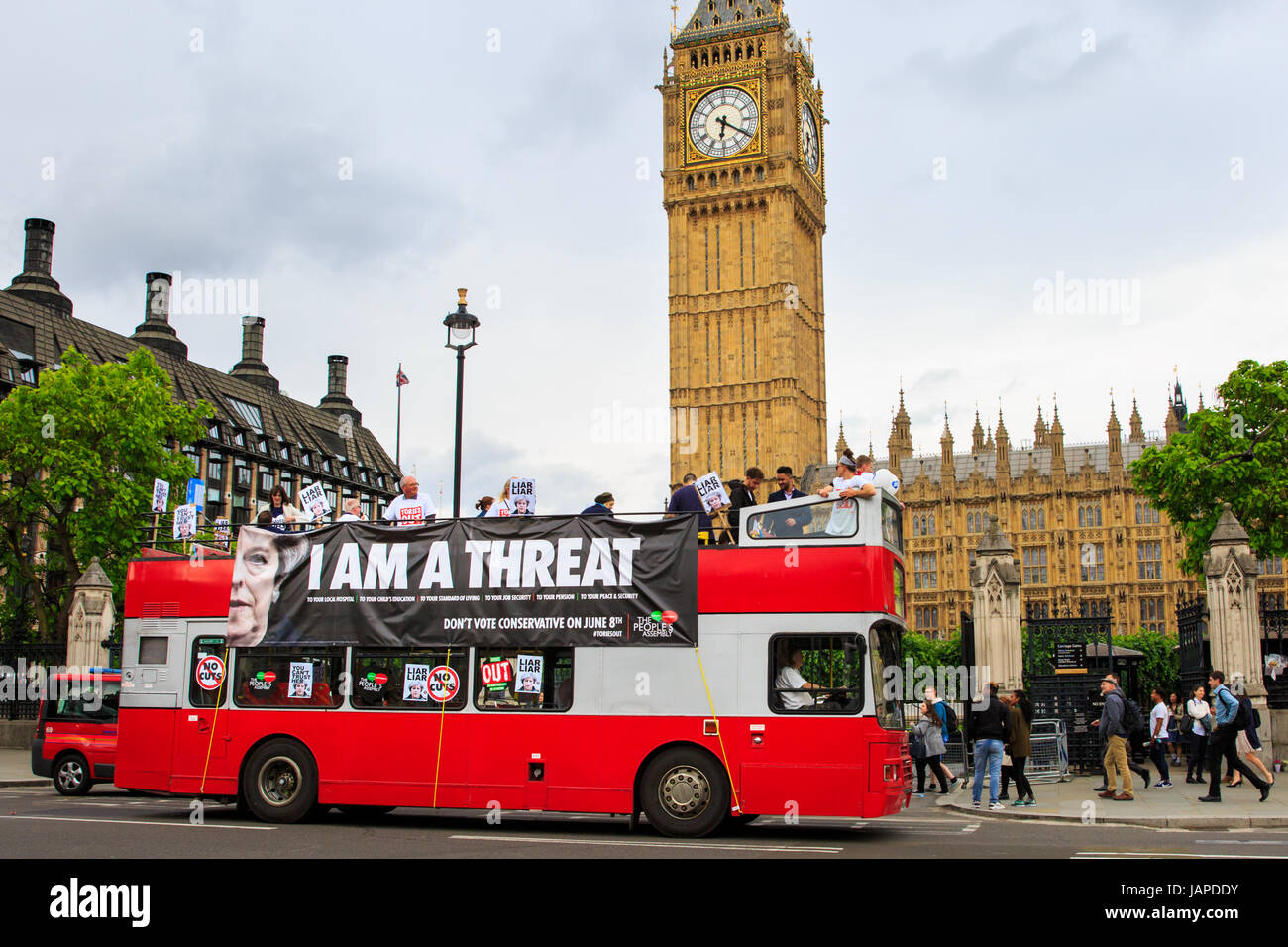 Westminster, London, UK, 7th June 2017. A red double decker bus branding Theresa May a 'Threat' travels - Stock Image