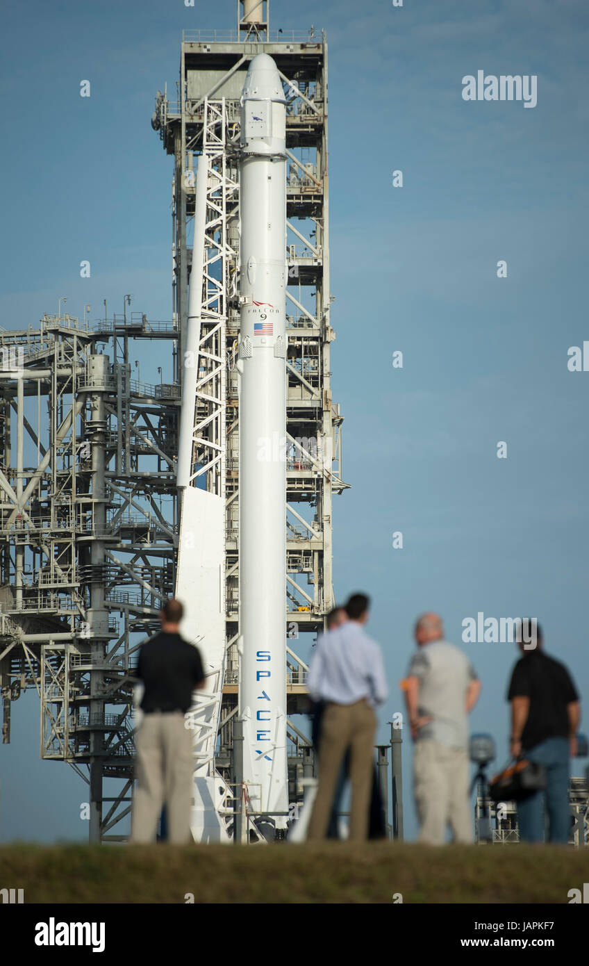 The SpaceX Falcon 9 rocket, with the Dragon spacecraft onboard, is seen shortly after being raised vertical at Launch - Stock Image
