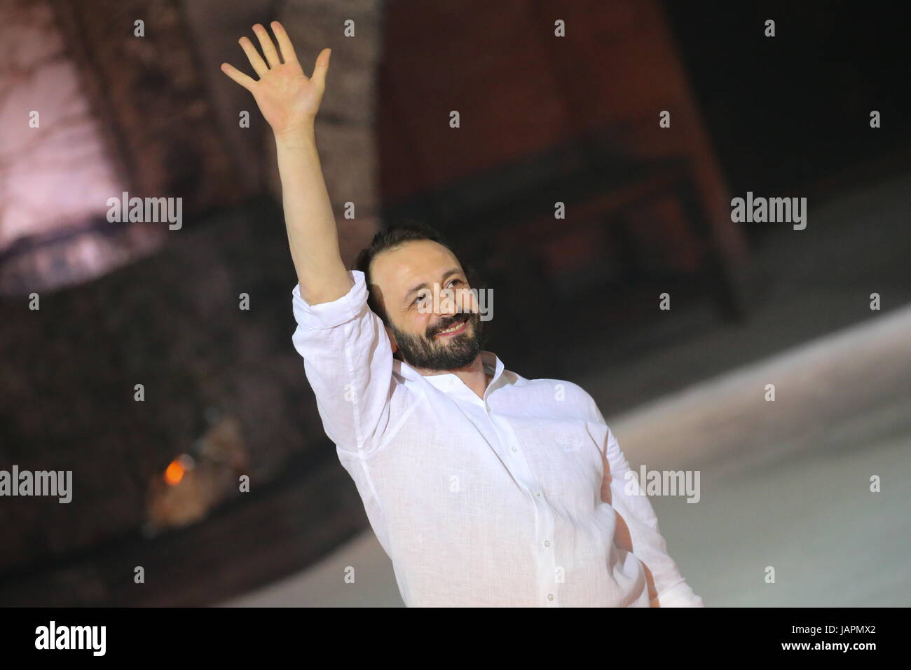 ST PETERSBURG, RUSSIA – JUNE 7, 2017: Ice dancer Ilya Averbukh acknowledges the audience of his Carmen ice show - Stock Image
