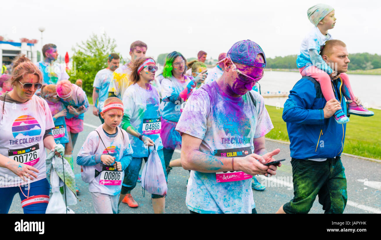 Poznan, Poland - May 20, 2017: Happy people participating in the Color Run. The Color Run is a worldwide hosted - Stock Image