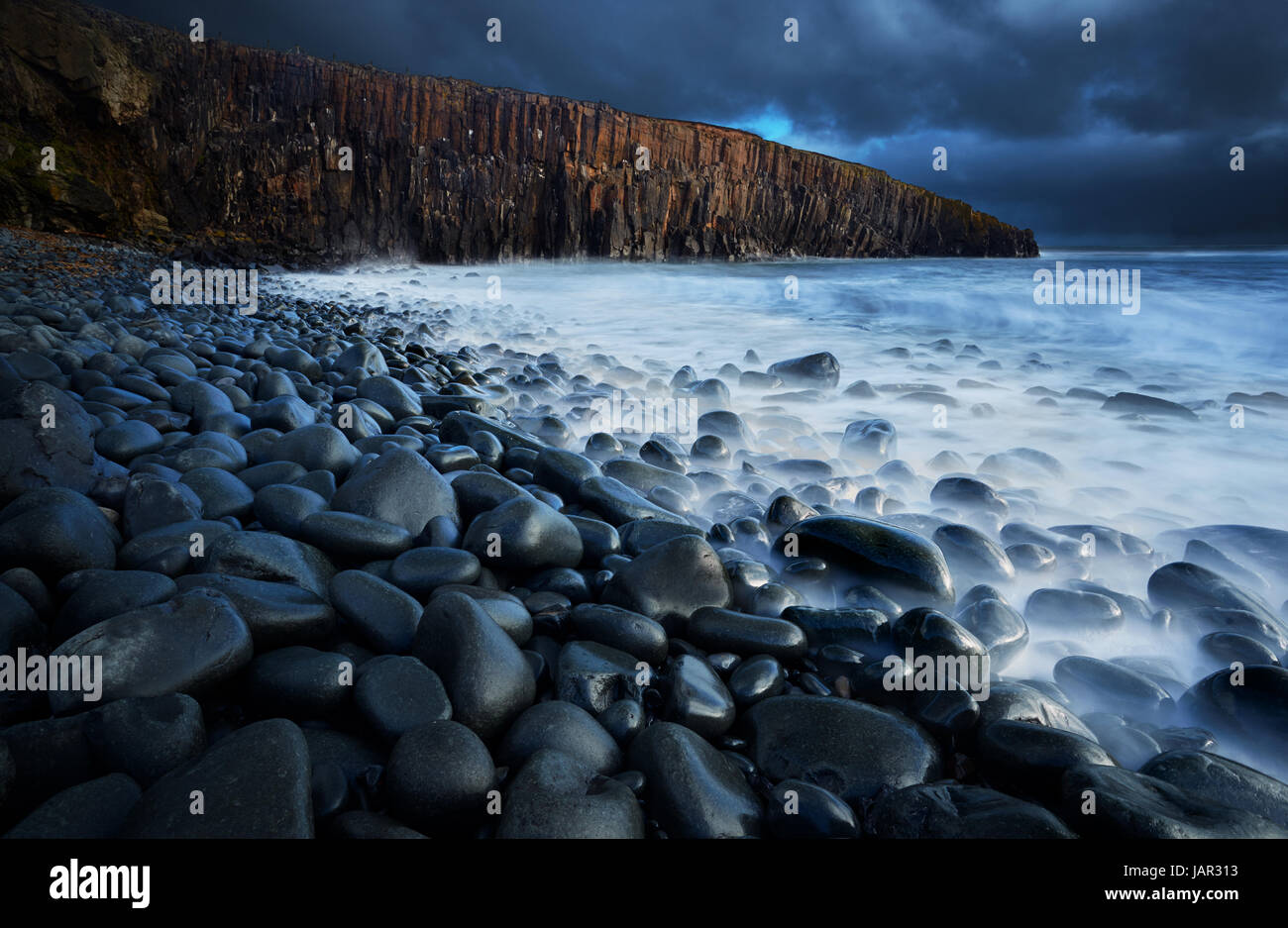 These spectacular Whin Sill cliffs lie to the south of Crastor on the Nothumberland coast. Stock Photo