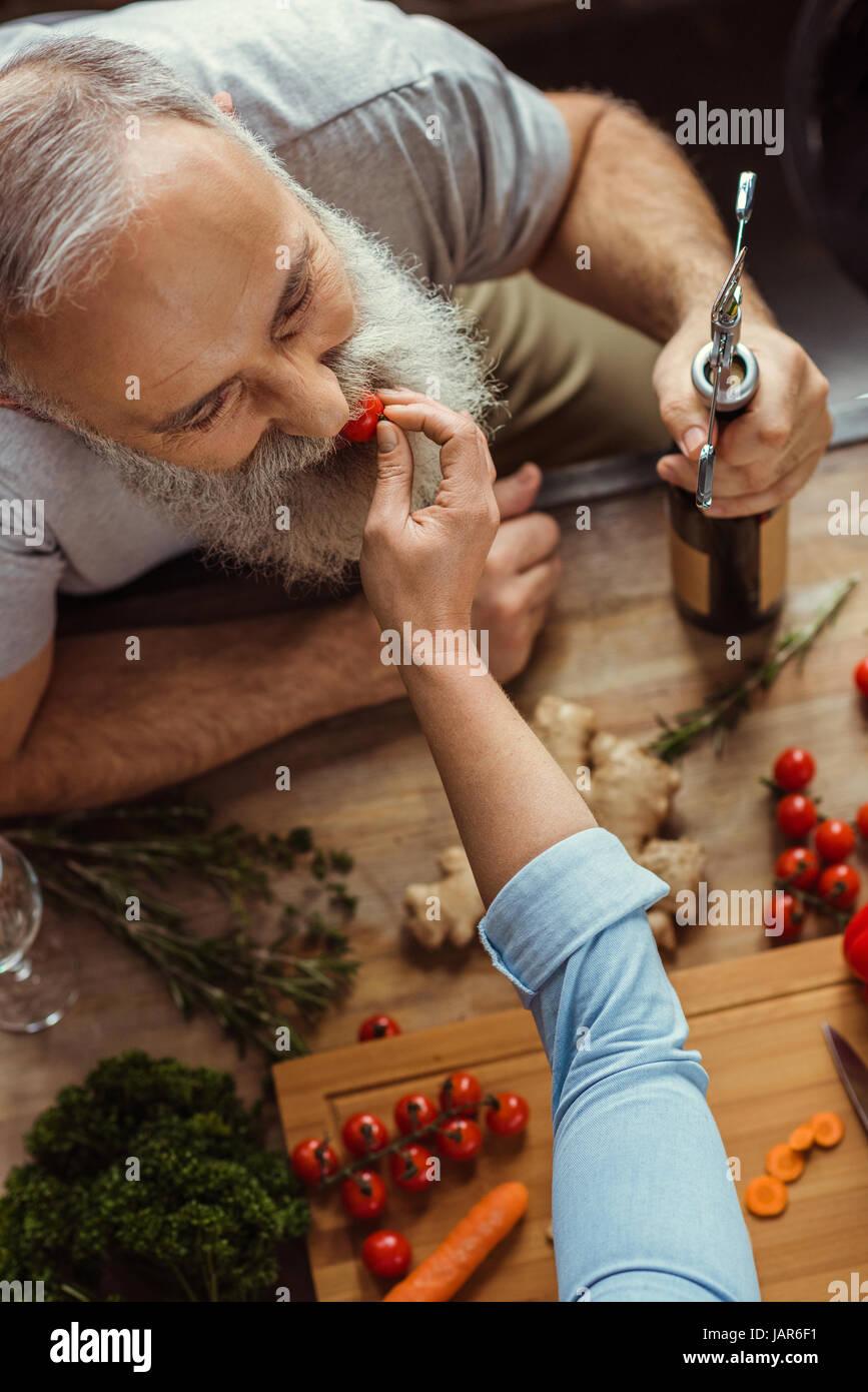 Woman feeding man - Stock Image