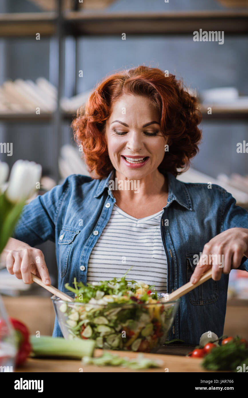 Woman cooking vegetable salad  - Stock Image