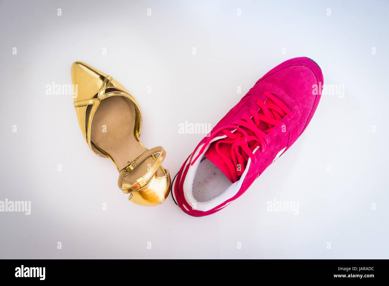 Gold and pink shoes - Stock Image