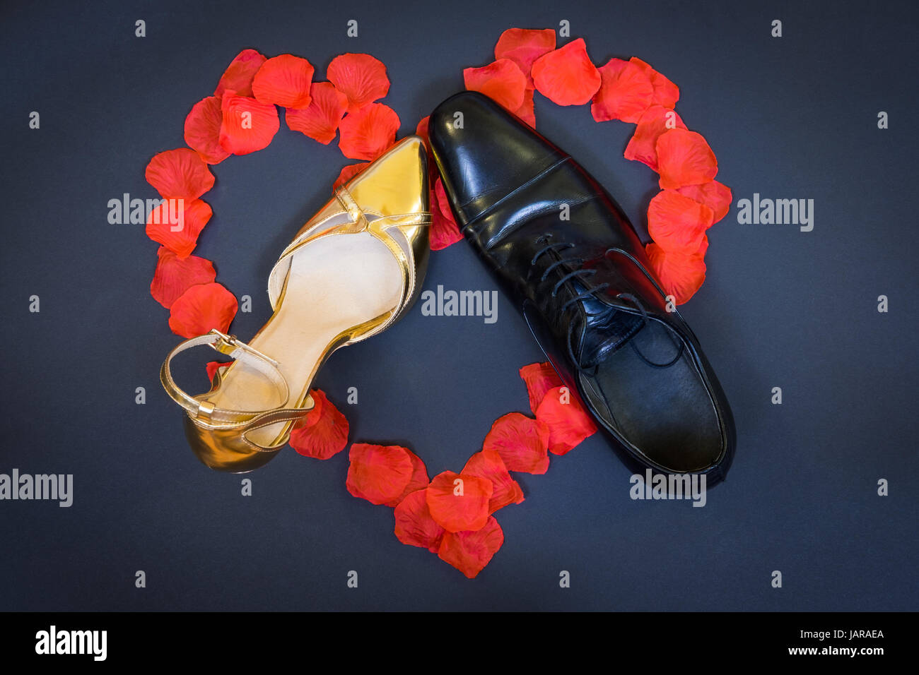 Black and Gold shoes - Stock Image