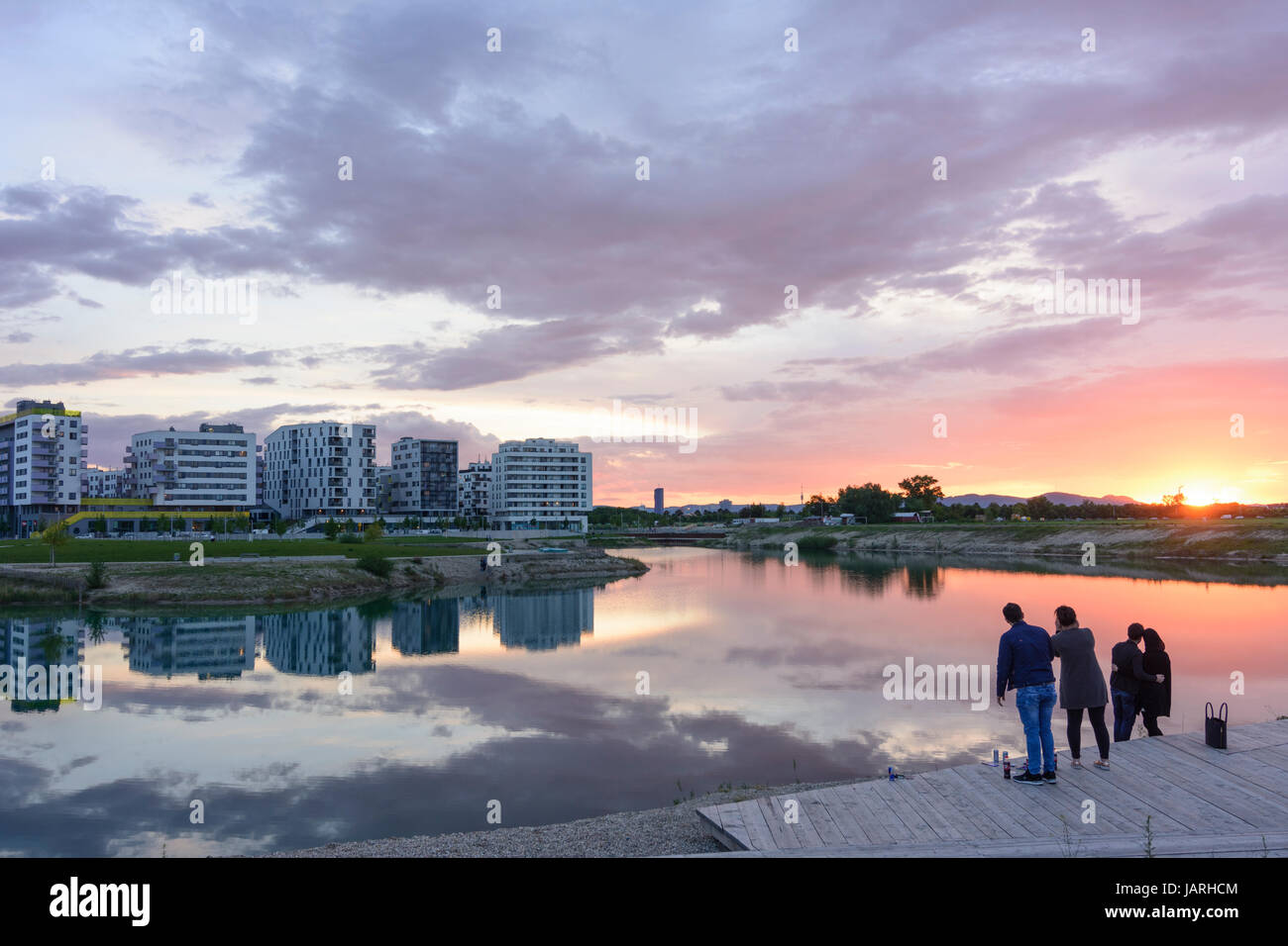 Seestadt (lake city) Aspern in construction, houses, lake, people take each others picture, Wien, Vienna, 22. Donaustadt, - Stock Image