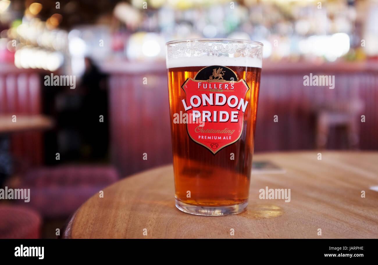 Pint of Fullers London Pride Best Bitter beer in British pub Stock Photo