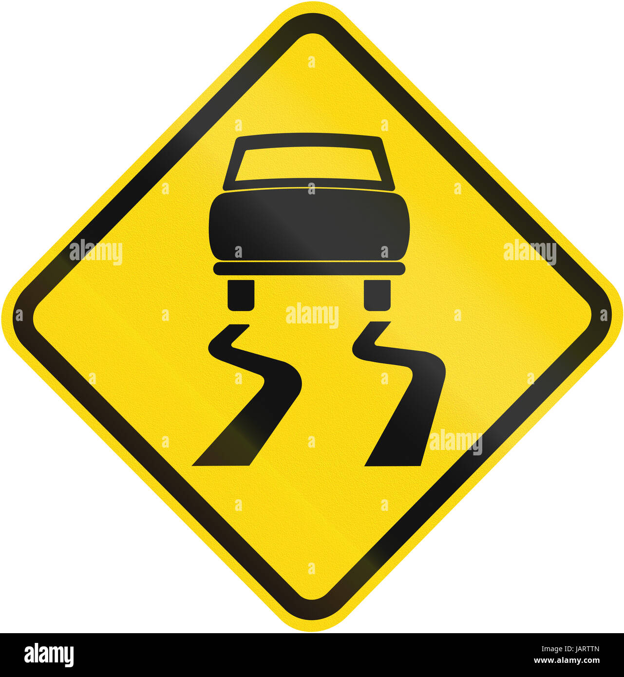 Road sign used in Brazil - Slippery road surface. - Stock Image