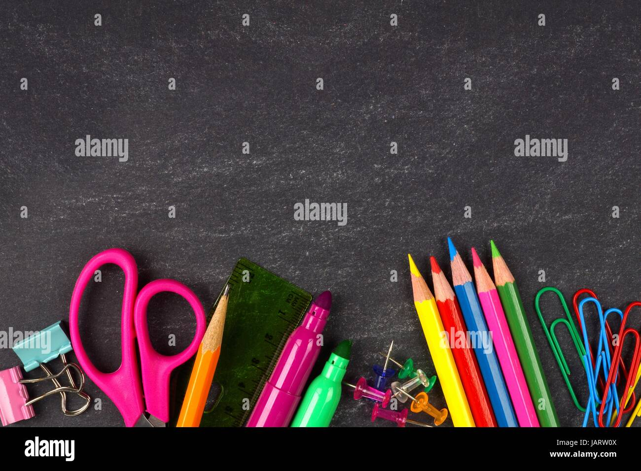 School Supplies Bottom Border On A Chalkboard Background