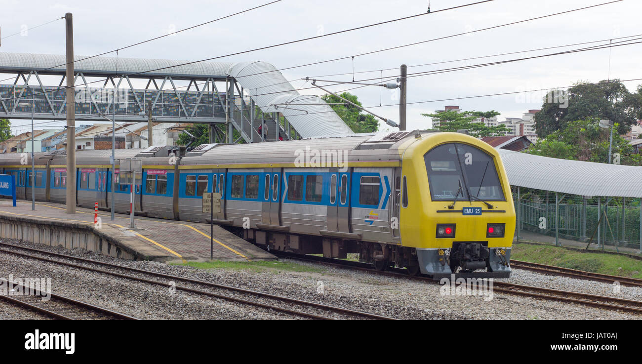 KTM Class 83 electric multiple unit train leaving Kajang station, Malaysia - Stock Image