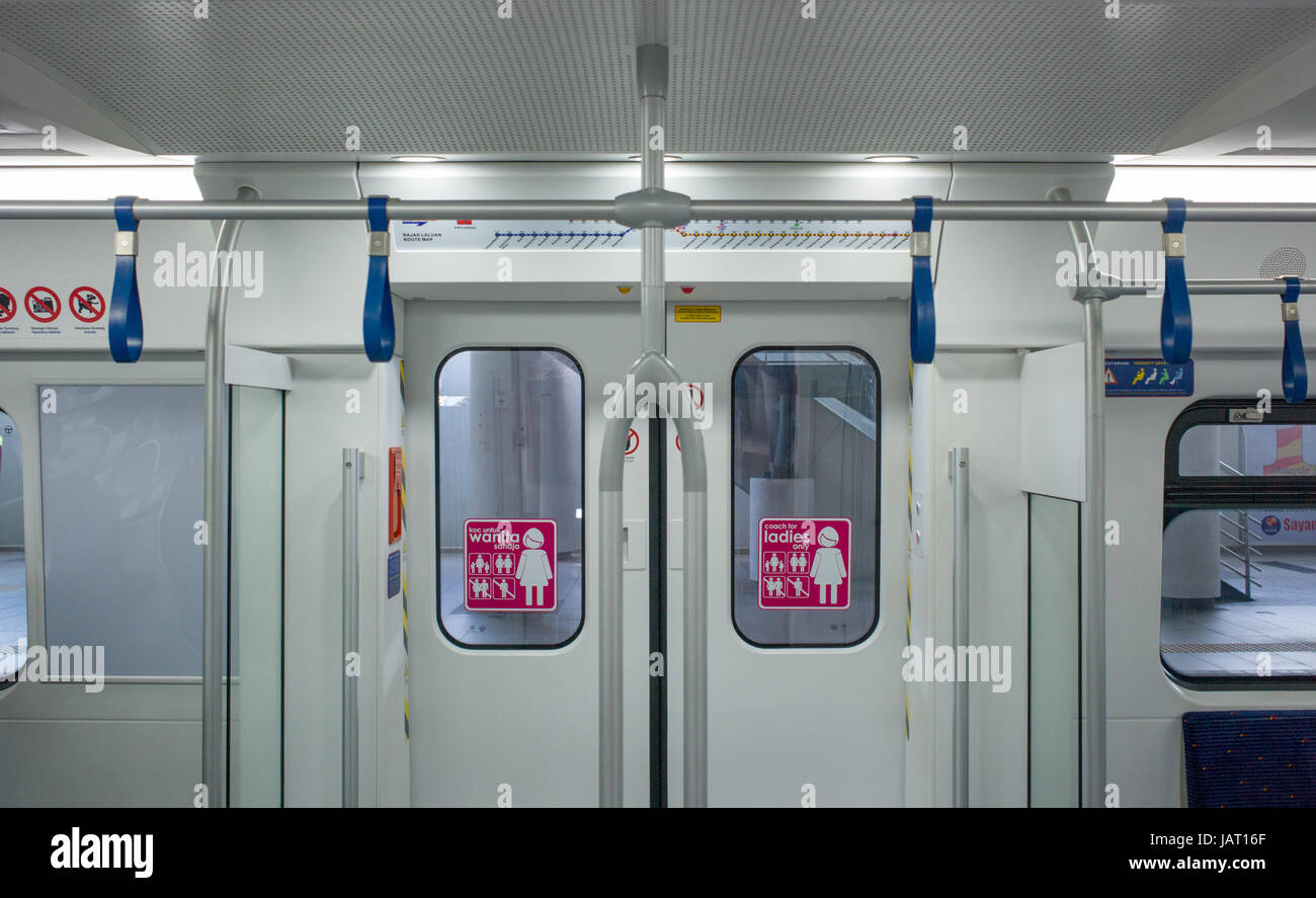 Signage on inside of doors of ladies-only coach in KTM Class 92 electric multiple unit train at Batu Caves station, - Stock Image
