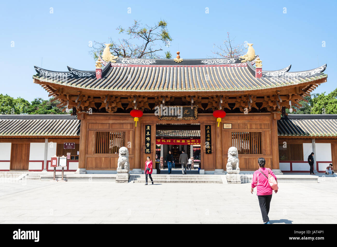 GUANGZHOU, CHINA - APRIL 1, 2017: people near entrance to Guangxiao Temple (Bright Obedience, Bright Filial Piety - Stock Image