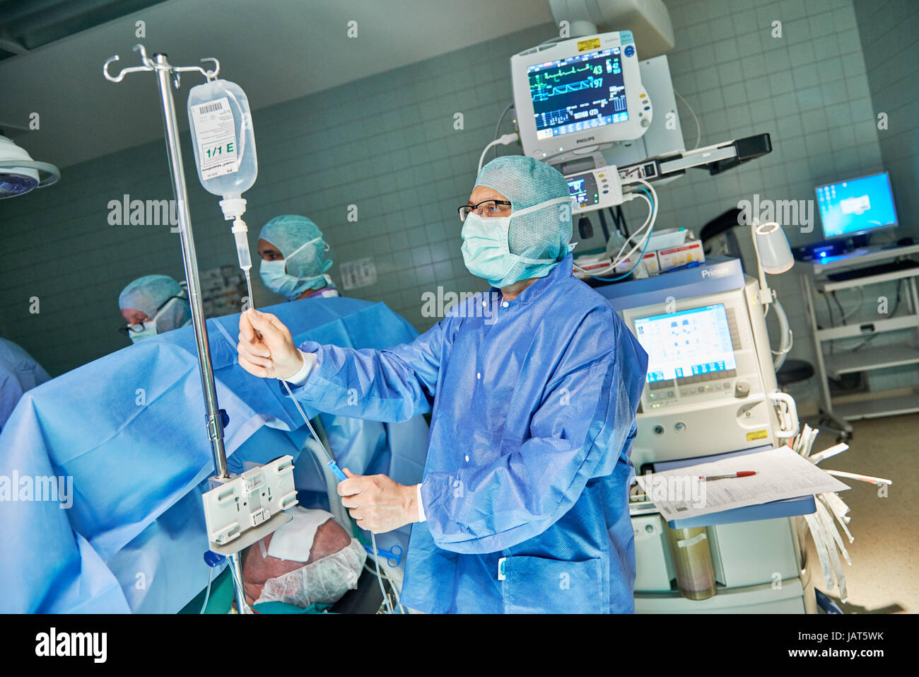 anesthetist at work,view of a medical team operating a patient - Stock Image
