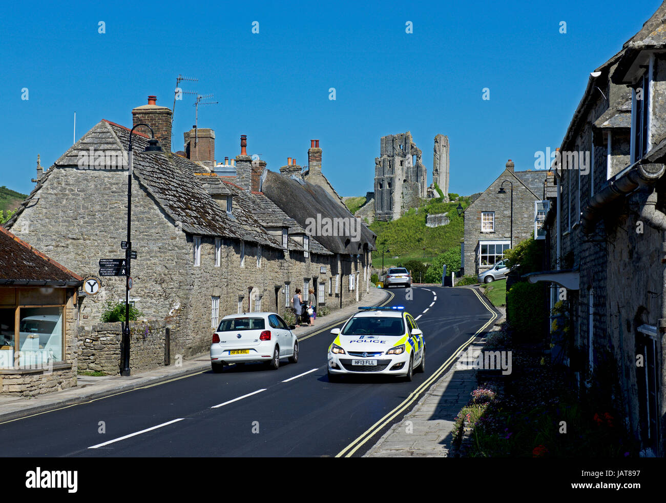 Police car on A351 in Corfe Castle, Dorset, England UK Stock Photo