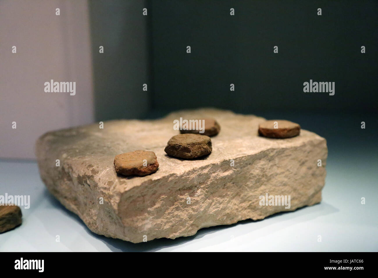 Gaming-Board block of stone. The gaming pieces are made out of shaped fragment of broken pots. From Giza. British - Stock Image