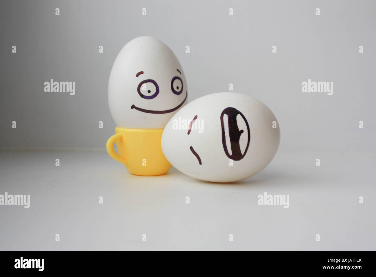 envy. Concept to get. Haste behind his back. Eggs with painted face. Photo for desig - Stock Image