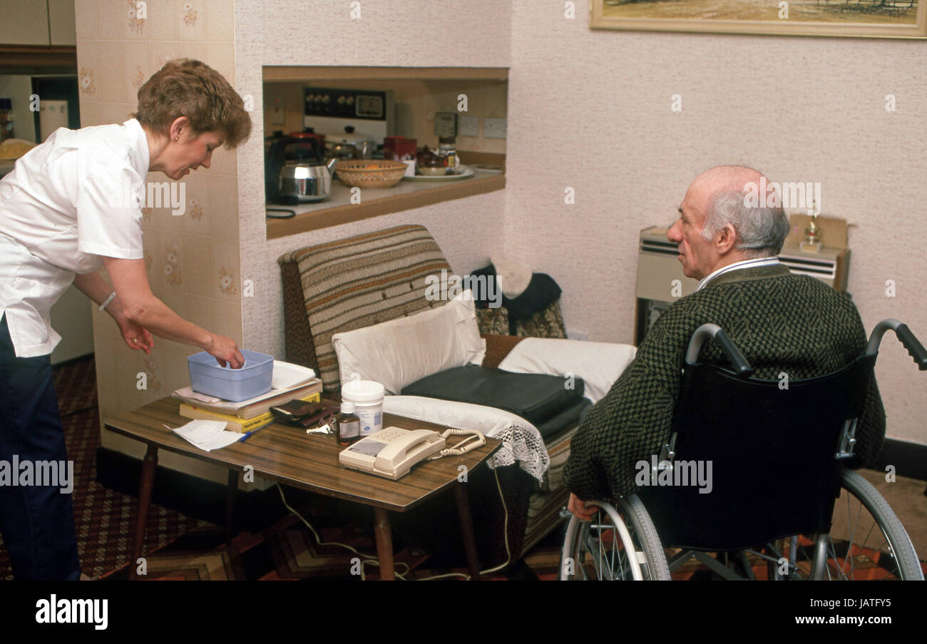home help carers district nurse on a home visit to elderly man in sheltered accommodation Stock Photo