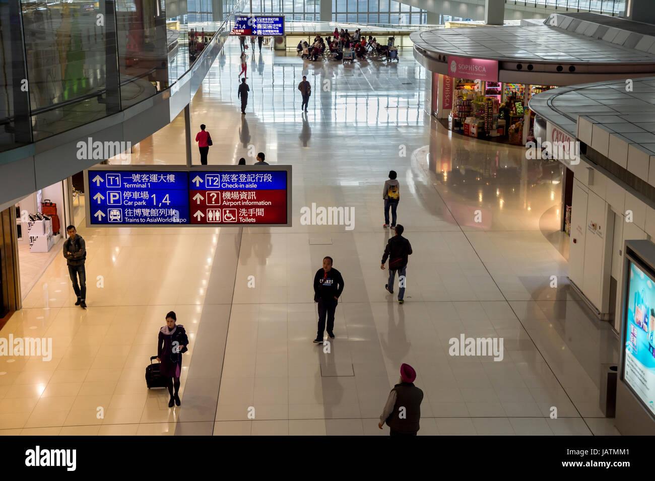 Hong Kong, China, 28th February 2015. Passengers walking in Hong-Kong Chek Lap Kok Airport. - Stock Image